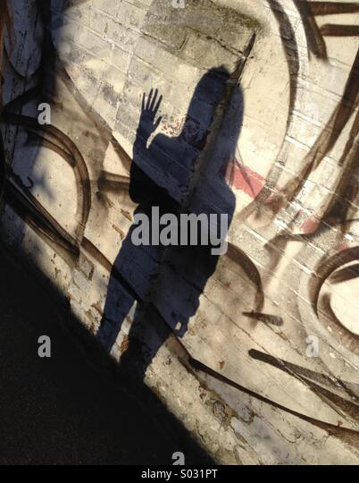 Shadow waving on wall - Stock Image