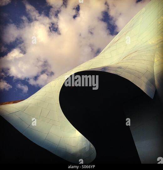 Clouds over EMP, Experience Music Project, designed by architect Frank Gehry, Seattle Center, Seattle, Washington - Stock Image