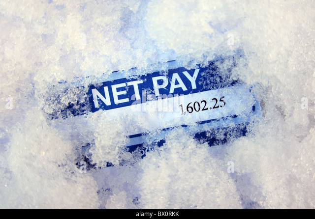PAYSLIP IN SNOWY FROZEN ICY CONDITIONS RE INCOMES PAY FREEZES MINIMUM WAGE MORTGAGES INTEREST RATES  ECONOMY ECONOMIC - Stock Image