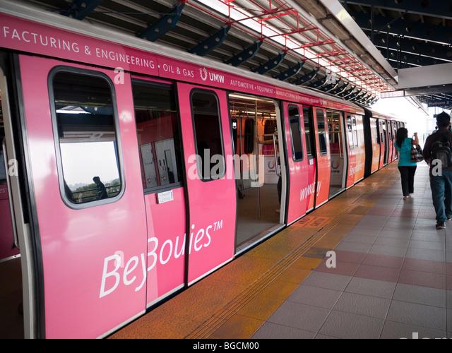 A LRT arrives at a modern station at Petaling Jaya - Stock Image