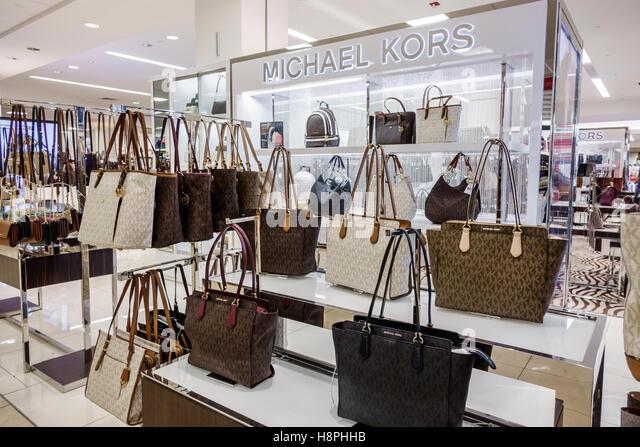 Florida Miami International Mall Macy's department store shopping sale display Michael Kors women's handbags - Stock Image