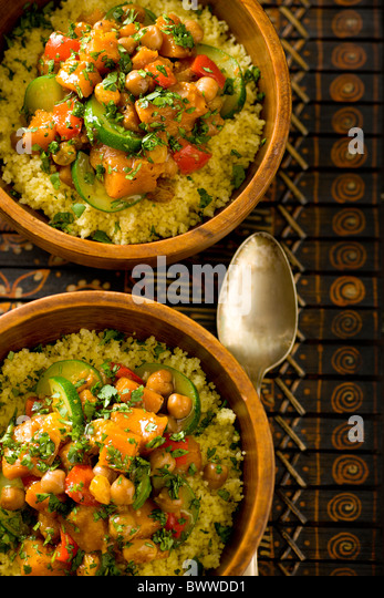 Moroccan Vegetable Stir-Fry with Chickepeas, Garam Masala, Butternut Squash, Zucchine, Raisins, Red Bell Pepper - Stock Image