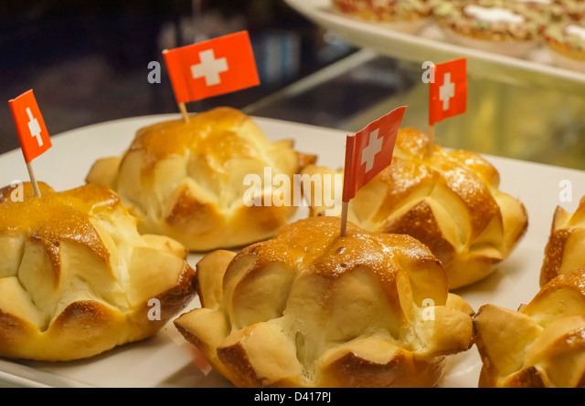 cake with little swiss flagg , white cross for 1 August National day, Switzerland Zurich , - Stock Image