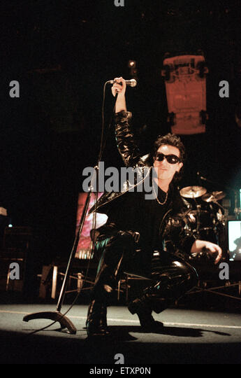 Rock group U2 performing on stage at the National Exhibition Centre in Birmingham, led by singer Bono. 1st June - Stock Image