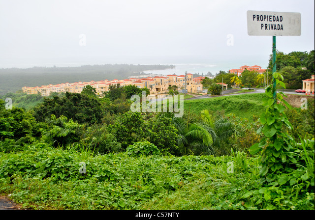 View of the villas and the ocean in Puerto Rico with 'private property' sign in the front. - Stock Image