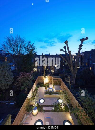 High level garden view at dusk. Notting Hill House, London, United Kingdom. Architect: Michaelis Boyd Associates - Stock-Bilder