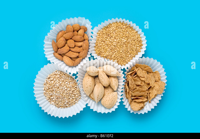 flax seed, almonds, cereal, steel cut oatmeal, almonds in shell - Stock Image