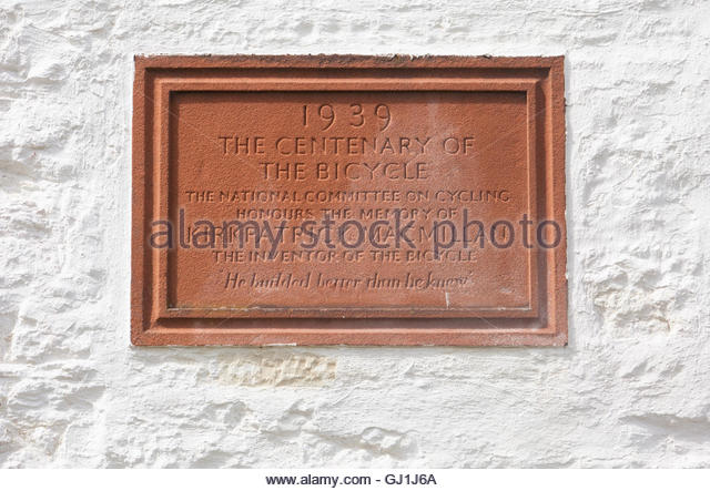 A stone plaque on the exterior wall of the building (a former smithy) near Penpont, where Kirkpatrick Macmillan, - Stock Image