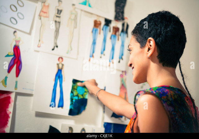 Confident entrepreneur, hispanic young woman working as fashion designer and dressmaker in atelier - Stock-Bilder