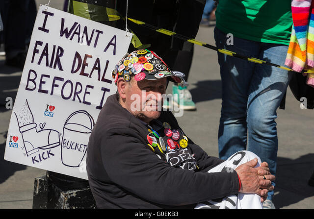 London, UK. 1 May 2016. Veteran political campaigner Terry Hutt in Trafalgar Square. May Day rally in London. Credit: - Stock Image