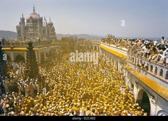 As Palanquin Carrying Images Khandoba Malshabai Leaves Temple Gate Crowd Explodes Into Ritual Slogans Covering Everyone - Stock Image