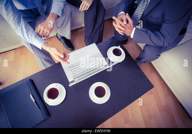 Business people having a meeting - Stock Image