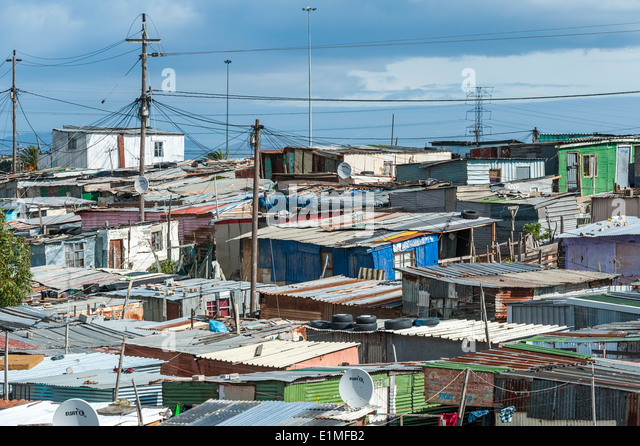 Colony of corrugated iron sheds in Khayelitsha, Cape Town, South Africa - Stock Image