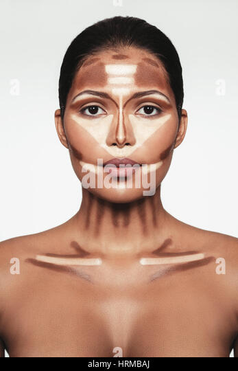 Close up portrait of contour and highlight makeup on female model. Professional contouring face makeup technique. - Stock Image