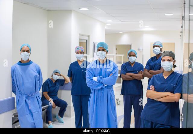 Team of doctors and nurses in hospital corridor - Stock Image