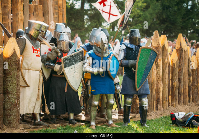 MINSK, BELARUS - JULY 19, 2014: Historical restoration of knightly fights on festival of medieval culture. The siege - Stock Image
