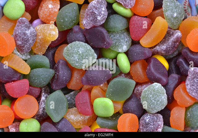 Mixed sweets of all colours - Stock Image