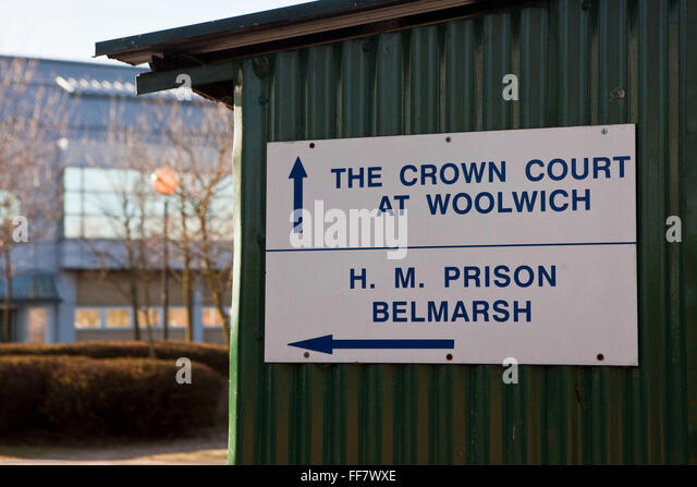 A sign showing the direction to Woolwich crown court & HMP Belmarh. - Stock Image