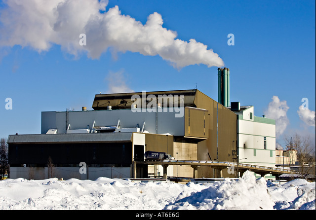 A garbage truck penetrates into the incinerator of Limoilou in Quebec City - Stock Image