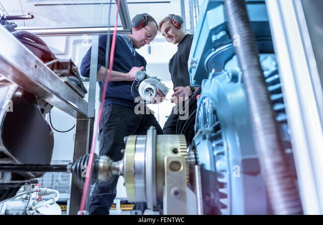 Scientists in turbo charger automotive research laboratory - Stock Image