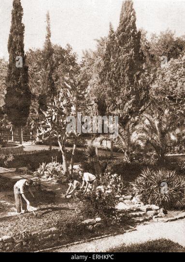 Palestine / Israel - early settlers / pioneers  tending their gardens. - Stock Image