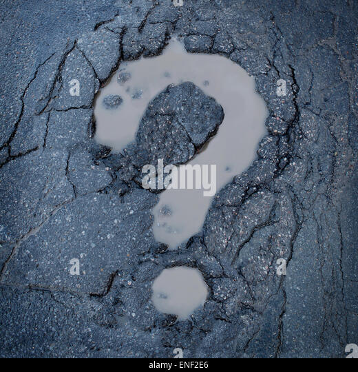 Road construction concept and city maintenance of infrastructure symbol as broken pavement or asphalt shaped as - Stock-Bilder