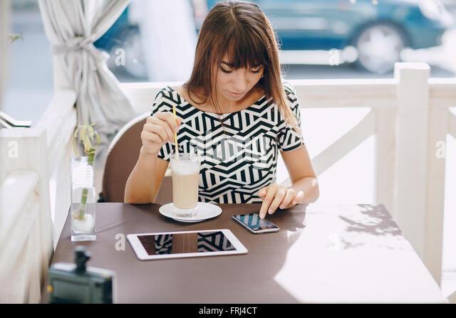 girl with phone - Stock-Bilder
