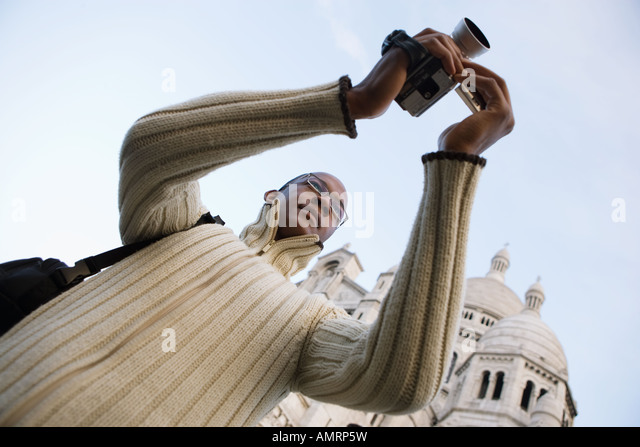 Low angle view of African man video recording - Stock-Bilder