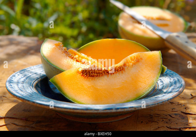 Fresh Canteloup melon slices - Stock Image