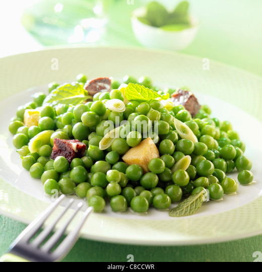 Peas with sausage and mint - Stock Image