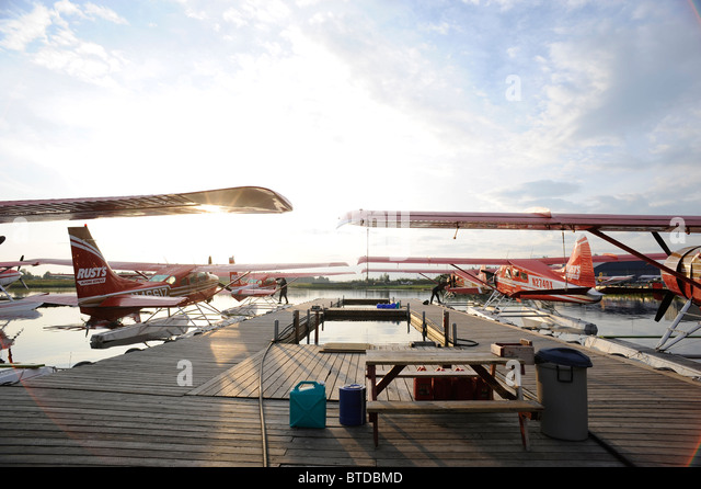 Group of Rust's Flying Service DeHavilland Beaver's docked on Lake Hood in Anchorage, Southcentral Alaska - Stock Image