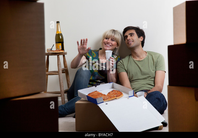 Couples first night in new apartment - Stock Image
