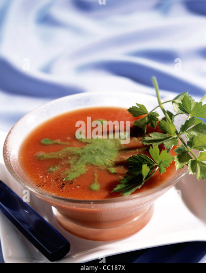 Tomato soup with pesto and parsley - Stock Image