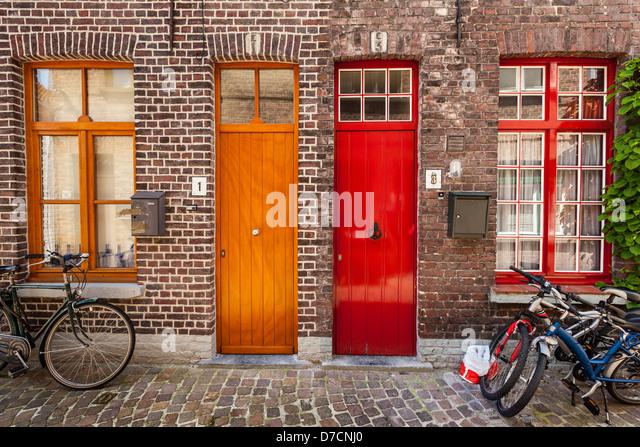 Doors of old houses and bicycles in european city. Bruges (Brugge), Belgium - Stock-Bilder