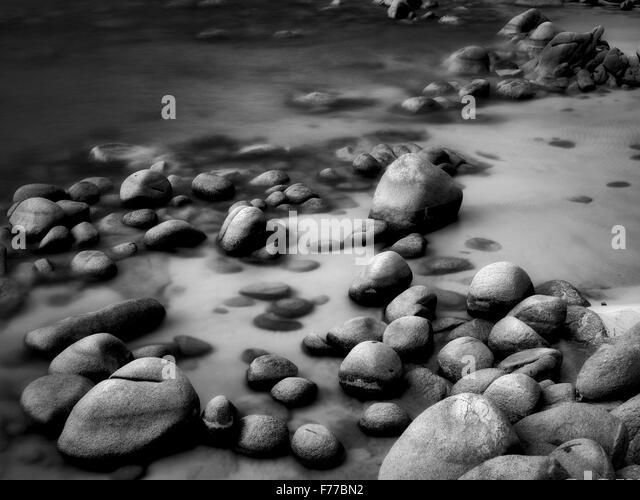 Boulders on beach shore of Lake Tahoe, Nevada - Stock Image