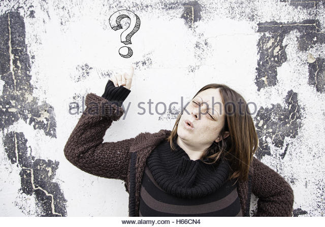 Girl serious doubt on urban street, problem - Stock Image