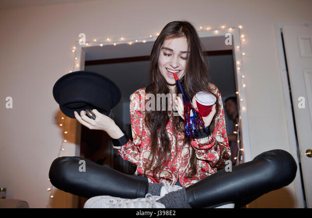 Young woman at a party - Stock Image