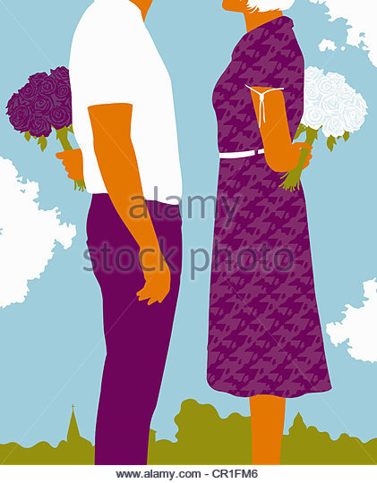 Couple standing with bouquets behind back - Stock Image