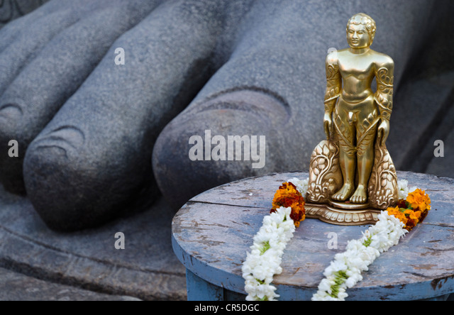 The small statue of Bahubali at the feet of the gigantic staue of Gomateshwara in Sravanabelagola, used for special - Stock Image