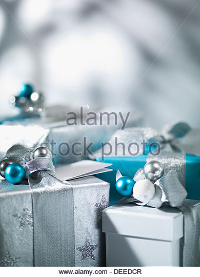Christmas gifts with silver ribbon - Stock Image