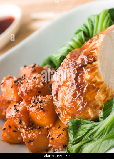 Soy Roasted Chicken on Steamed Pac Choi with Teriyaki Roasted butternut Squash - Stock Image