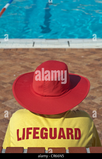 South Africa, Western Cape, Cape Town, Sea Point, outdoor swimming pool on the seaside, pool attendant, lifeguard - Stock Image