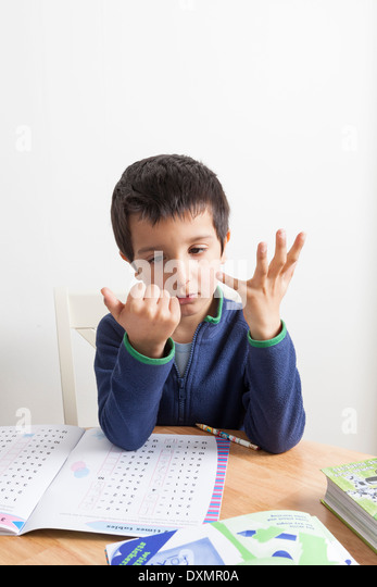Schoolboy l counting on his fingers - Stock Image