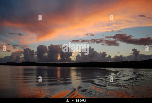 The sun setting over the Puerto Mosquito mangrove bay in Vieques, Puerto Rico. The bay is bioluminescent. - Stock Image