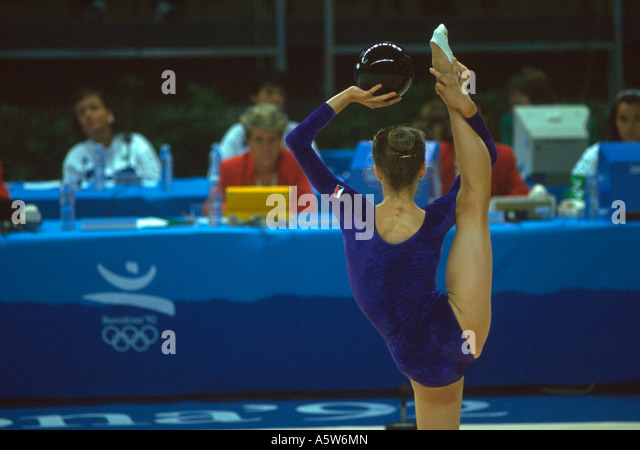 Painet hl0769 olympic gymnast competition olympics athlete gymnastics girl high kick pose posing national pride - Stock Image
