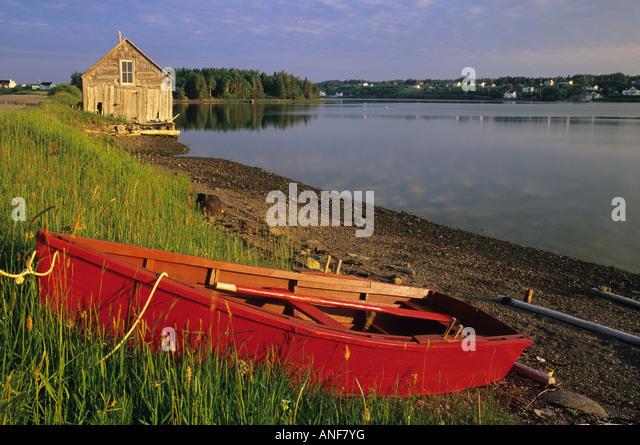 Boats on shoreline, River Bourgeois, Cape Breton, Nova Scotia, Canada. - Stock Image