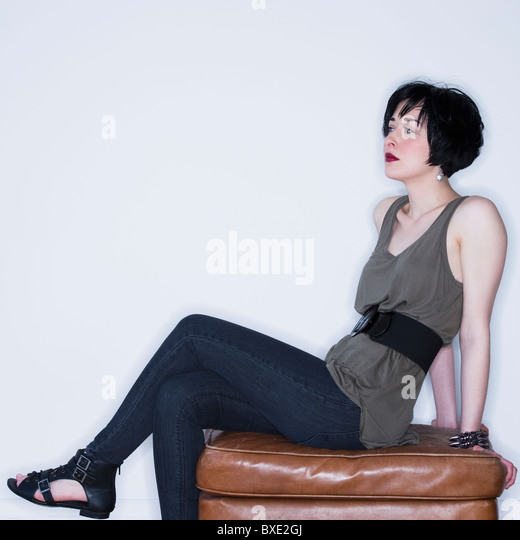 Leather upholstery stock photos leather upholstery stock for Ottoman to sit on