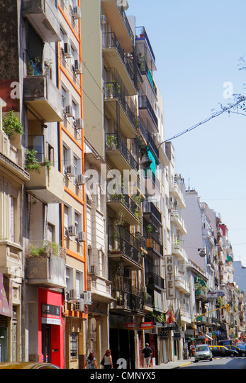Buenos Aires Argentina Avenida Montevideo street scene neighborhood urban housing apartment buildings hotel facade - Stock Image