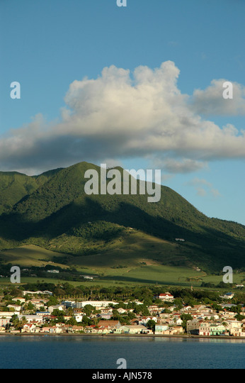 St Kitts green mountains coast Shore taken from cruise ship approaching Basseterre town - Stock Image