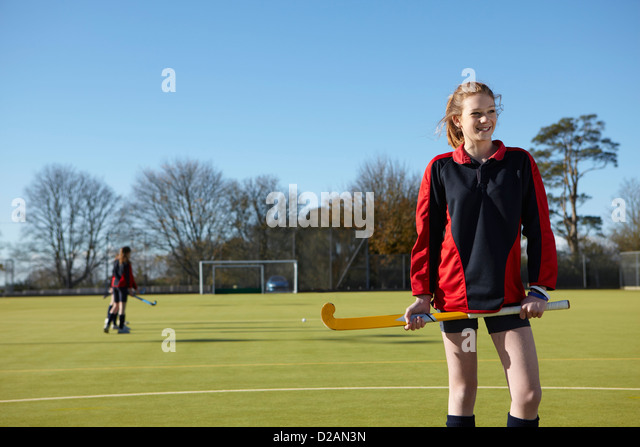 Lacrosse player standing in field - Stock Image